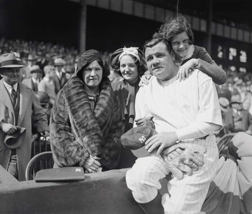 PHOTO: Babe Ruth and his family, Mrs. Ruth and his daughters Julia,center, and Dorothy is behind him, at Yankee Stadium, April 24, 1934.
