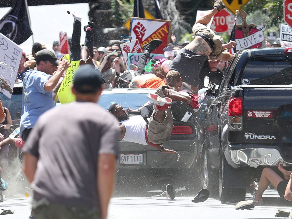 PHOTO: A vehicle plows into a group of protesters marching along 4th Street NE at the Downtown Mall in Charlottesville, Va., on the day of the Unite the Right rally, Aug. 12, 2017.