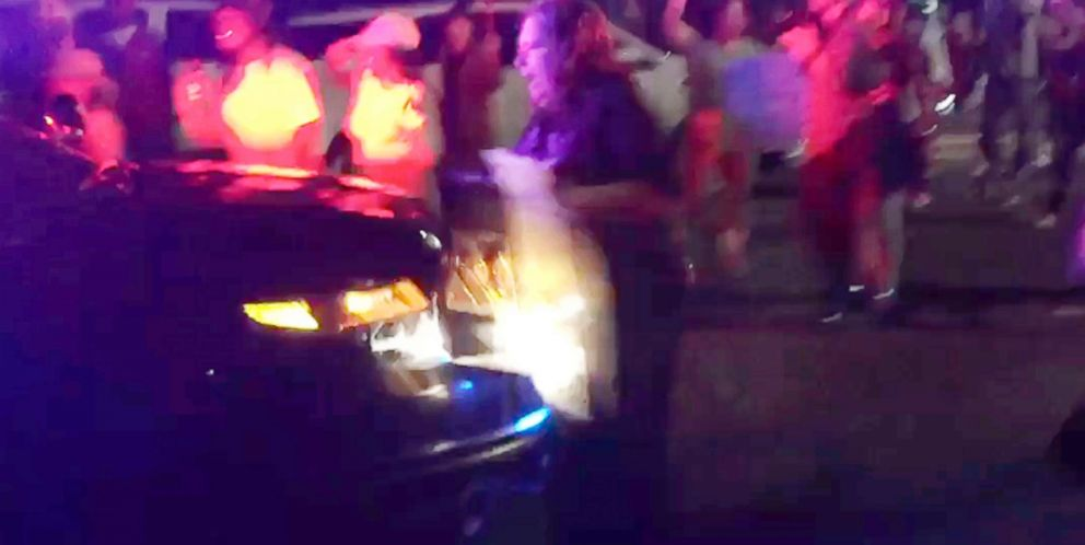 PHOTO: This photo made from video by Guy Danilowitz on March 31, 2018, shows a woman being struck by a Sacramento County Sheriffs patrol vehicle during a demonstration over the shooting of an unarmed black man by Sacramento police.