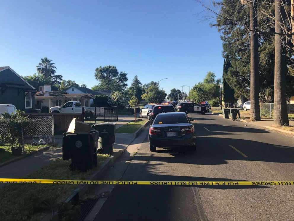 PHOTO: Sacramento, Calif., police were stationed outside a home where a man shot and killed an officer and holed up inside the residence on Wednesday, June 19, 2019.