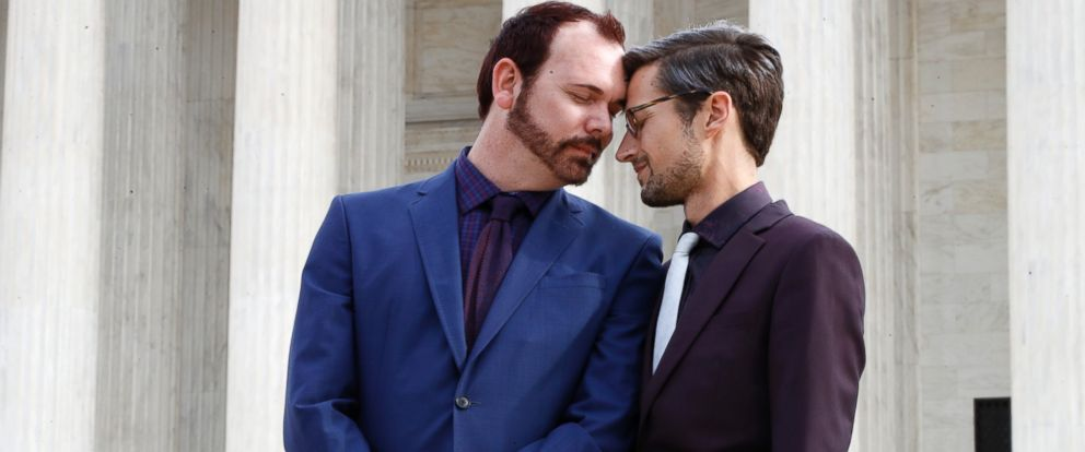In this Dec. 5, 2017 file photo, Charlie Craig, left, and David Mullins touch foreheads after leaving the Supreme Court in Washington.