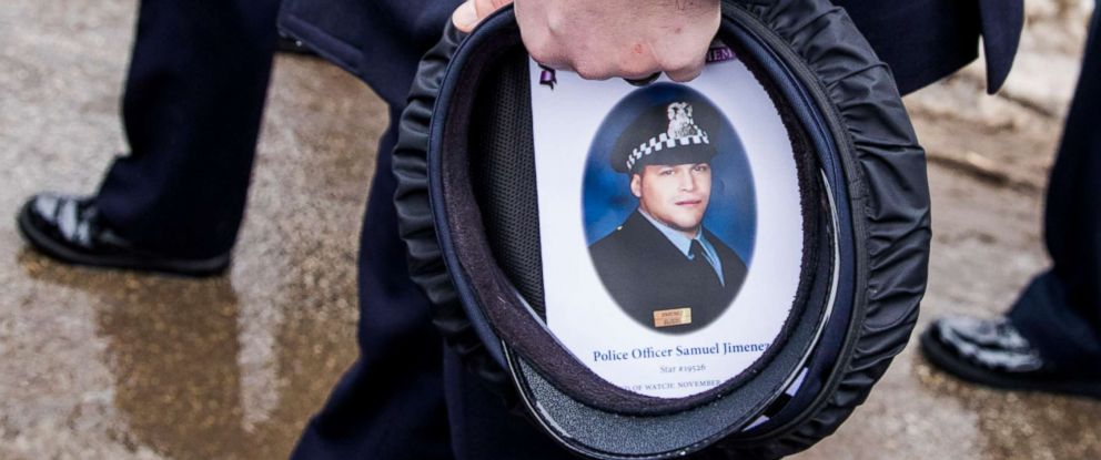 PHOTO: A Chicago police officer carries his hat with the funeral program for slain officer Samuel Garcia placed inside it following funeral services at the Chapel of St. Joseph at the Shrine of Our Lady of Guadalupe in Des Plaines, Ill., Nov. 26, 2018.
