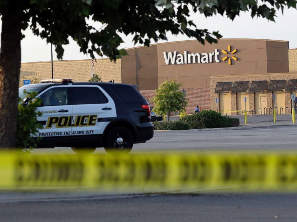 PHOTO: San Antonio police officers investigate the scene where eight people were found dead in a tractor-trailer outside of a Walmart store in stifling heat in what police are calling a horrific human trafficking case, July 23, 2017, in San Antonio.