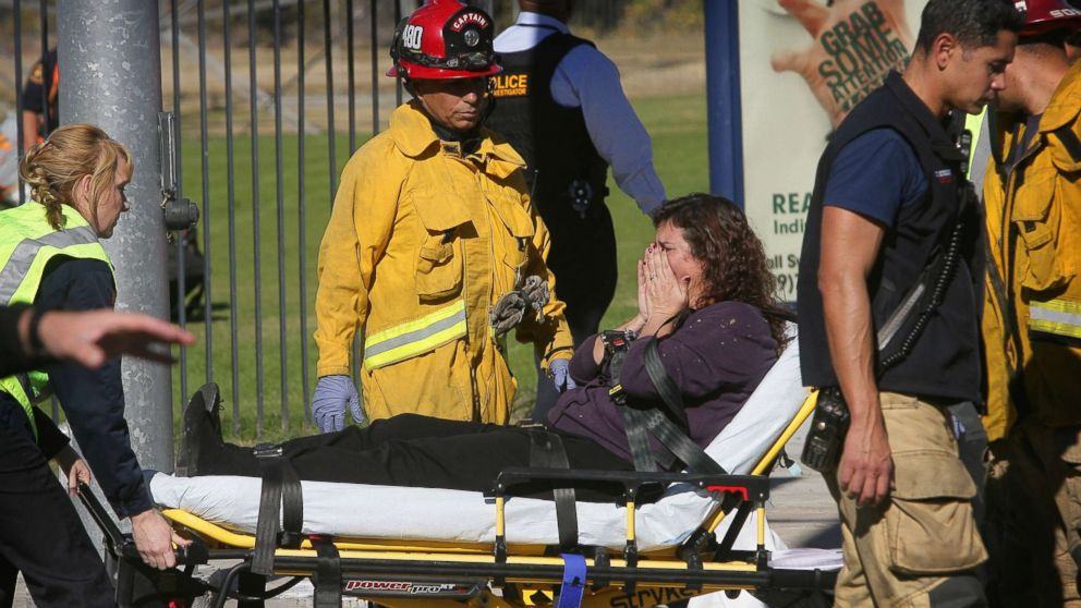 A victim is wheeled away on a stretcher following a shooting that killed 14 people at a social services facility, Dec. 2, 2015, in San Bernardino, Calif.