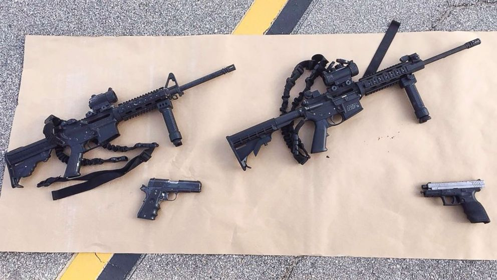 Four guns are seen near the site of a shootout between police and suspects in the San Bernardino shootings, Dec. 4, 2015, in San Bernardino, Calif, in this handout photo provided by the San Bernardino County Sherrif's Department.