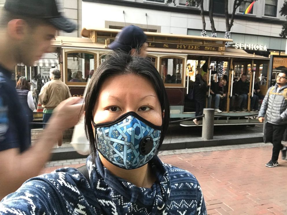 PHOTO: Jenny Shao, a graduate student in San Francisco, dons a mask Friday, Nov. 16, 2018, to protect from the citys poor air quality due to the Camp Fire.