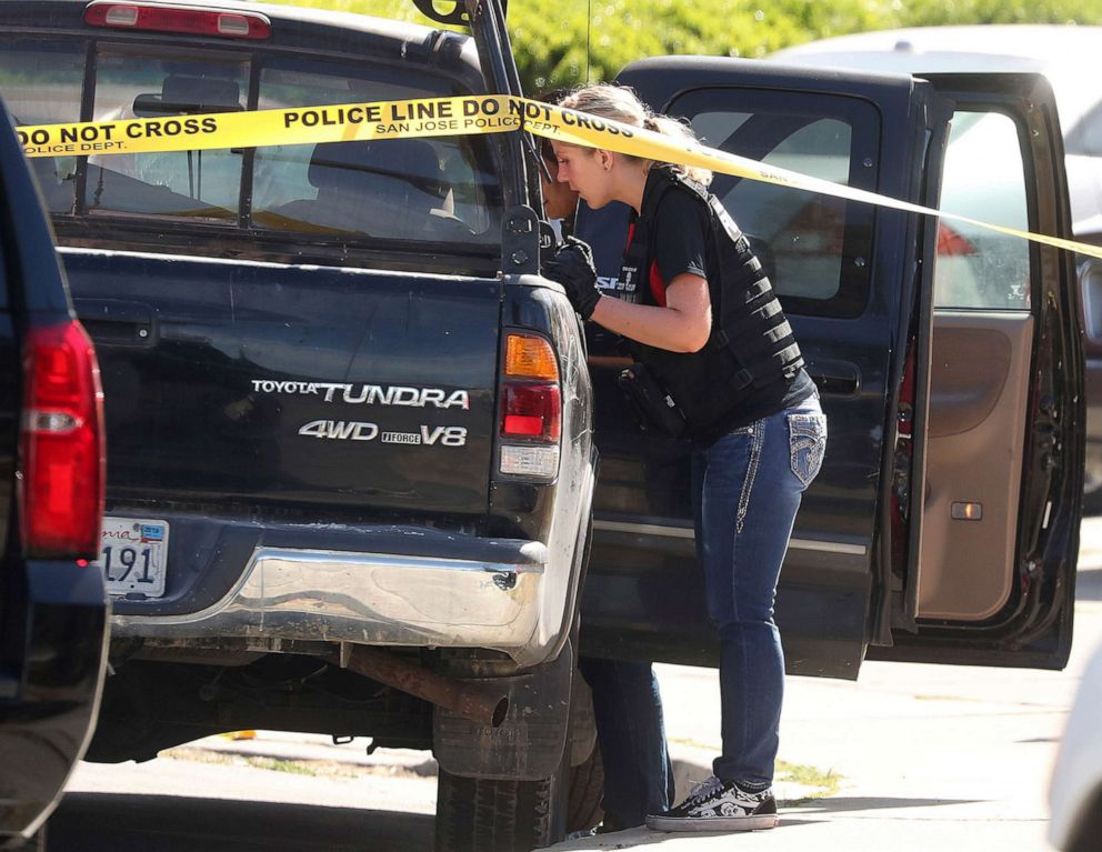PHOTO: A forensic analyst with the San Jose Police Department searches a truck near scene where five people were killed Monday, June 24, 2019, in San Jose, Calif.