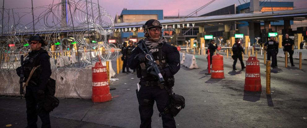 PHOTO: U.S. Customs and Border Protection Special Response Team officers stand guard at the San Ysidro Port of Entry after the land border crossing was temporarily closed to traffic from Tijuana, Mexico, Nov. 19, 2018.