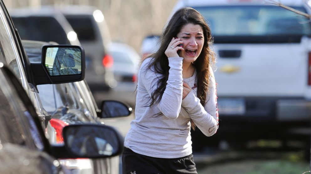 In this Dec. 14, 2012 file photo, Carlee Soto uses a phone to ask about her sister, Victoria Soto, a teacher at the Sandy Hook Elementary School in Newtown, Conn., after gunman Adam Lanza killed 26 people inside the school, including 20 children. Victoria Soto, 27, was among those killed.