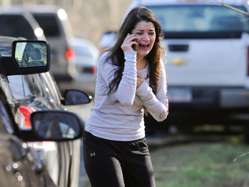 PHOTO: In this Dec. 14, 2012 file photo, Carlee Soto uses a phone to ask about her sister, Victoria Soto, a teacher at the Sandy Hook Elementary School in Newtown, Conn., after gunman Adam Lanza killed 26 people inside the school, including 20 children.