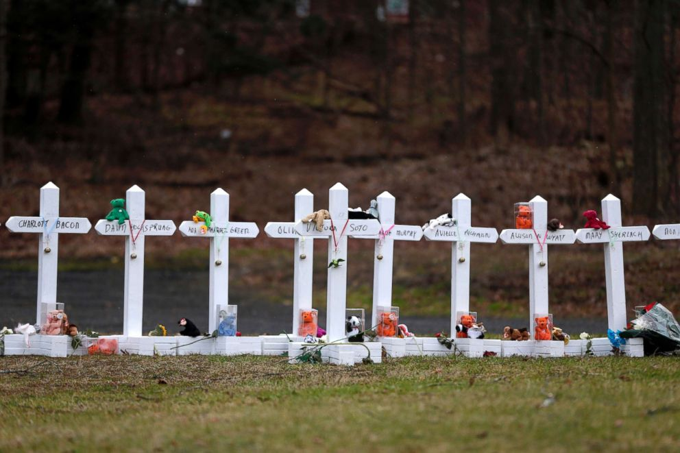 PHOTO: Crosses bearing the names of the Newtown shooting victims are displayed in the Sandy Hook village of Newtown, Conn., Dec. 22, 2012.