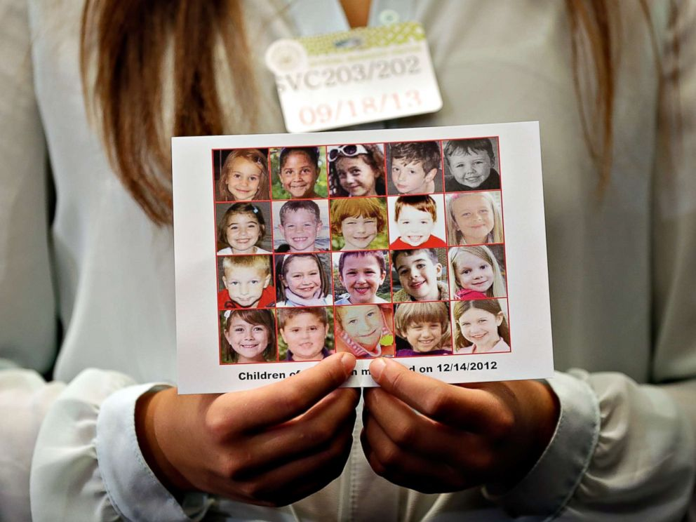 PHOTO: Kyra Murray holds a photo showing victims of the shooting at Sandy Hook Elementary School during a press conference at the U.S. Capitol calling for gun reform legislation, Sept. 18, 2013, in Washington, D.C.