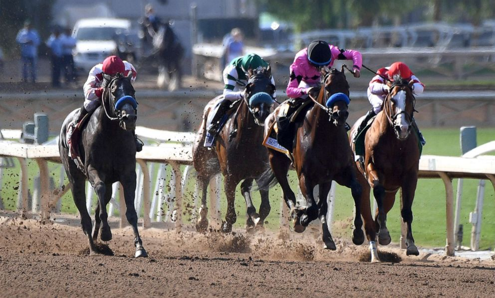 PHOTO: Roadster, right, with jockey Mike Smith, heads to the finish and the win in the Santa Anita Derby horse race at Santa Anita in Arcadia, Calif., April 6, 2019.