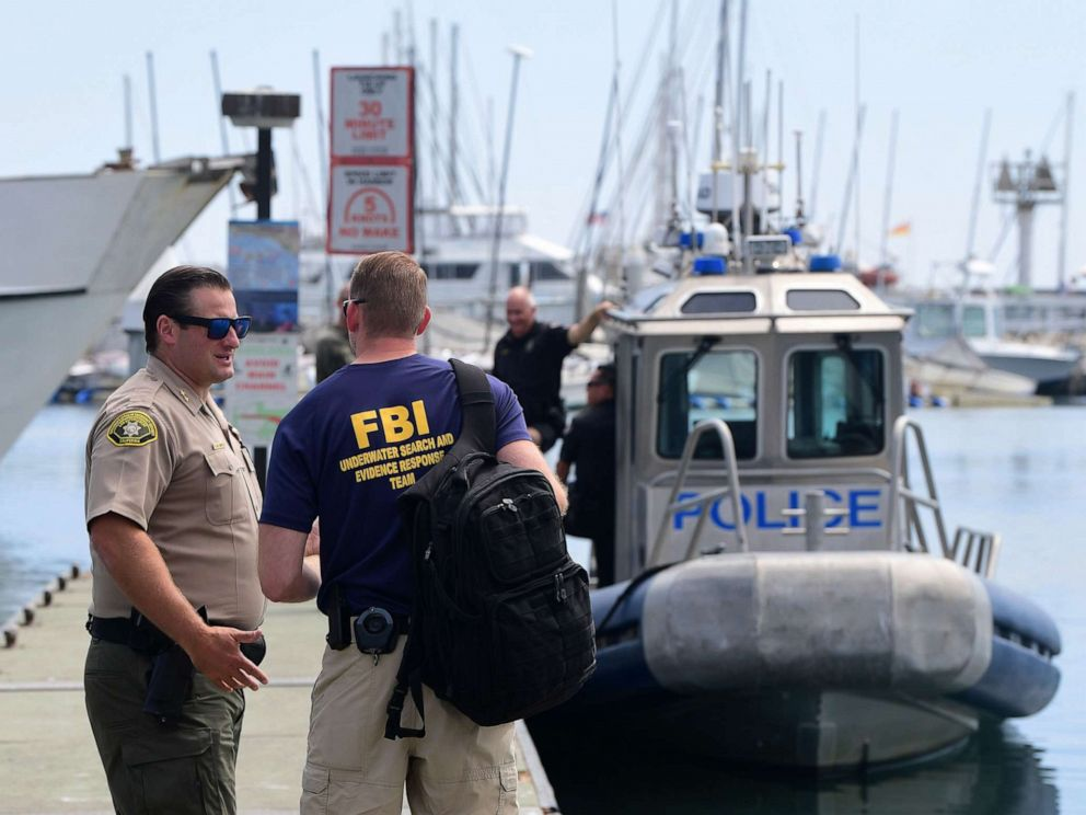 PHOTO: An officer from the FBI underwater search and evidence response team speaks with a California law enforcement officer near a Long Beach Police vessel in Santa Barbara, Calif., Sept. 3, 2019.