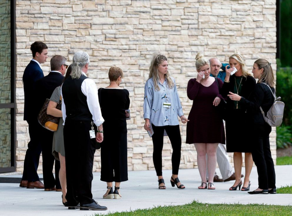 PHOTO: Mourners leave from the Bay Area Christian Church on May 25, 2018, in League City, Texas, after the funeral for Cynthia Tisdale, a substitute teacher who was killed during the mass shooting at Santa Fe High School.