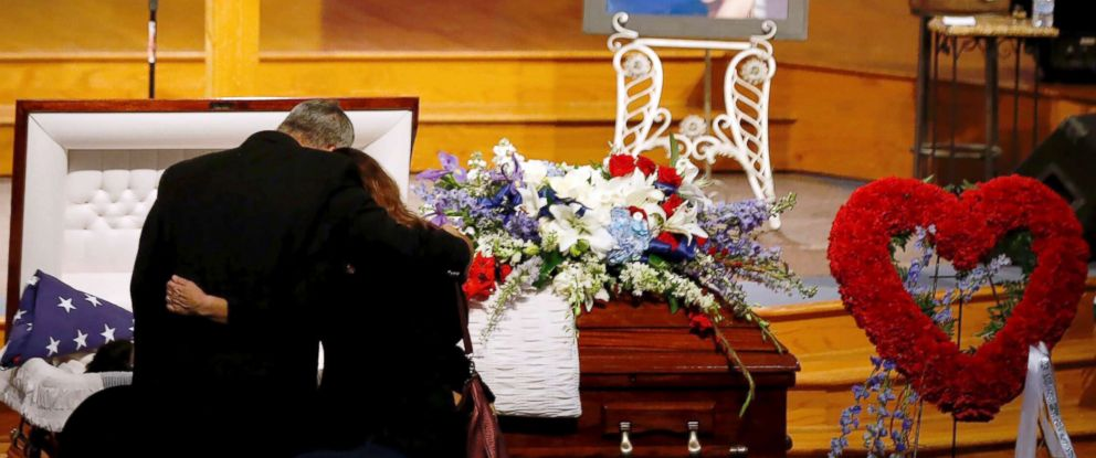 PHOTO: Mourners embrace in front of Christian Riley Garcias casket during a funeral service at Crosby Church on May 25, 2018, in Crosby, Texas.