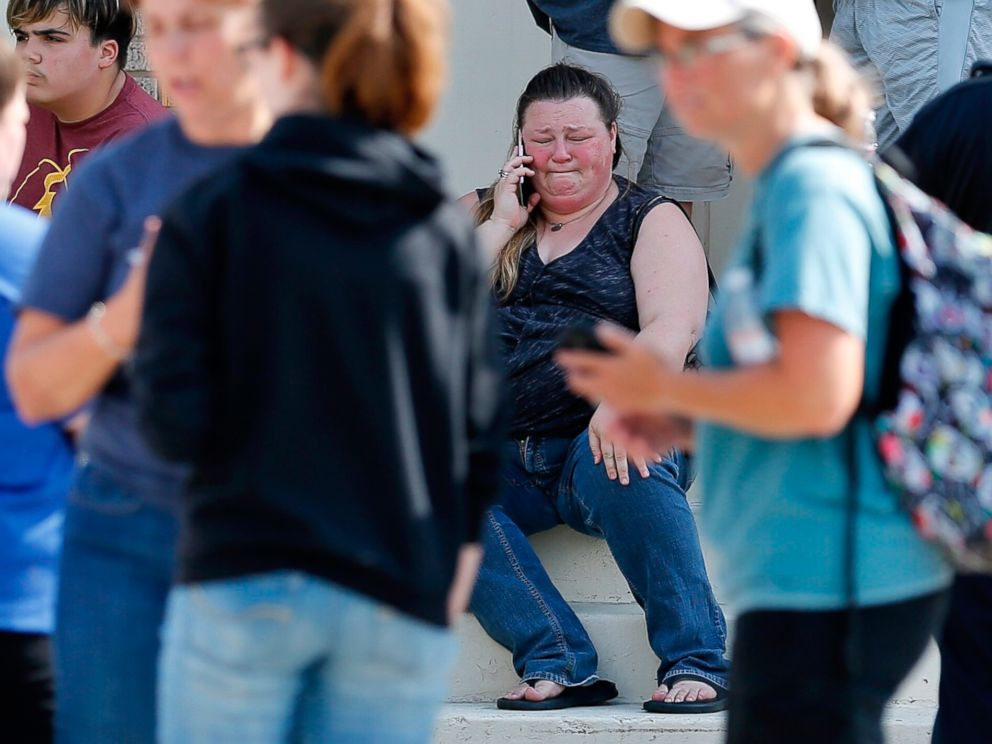 PHOTO: A woman reacts while making a phone call outside the Alamo Gym where parents wait to reunite with their children following a shooting at Santa Fe High School in Santa Fe, Texas, May 18, 2018.