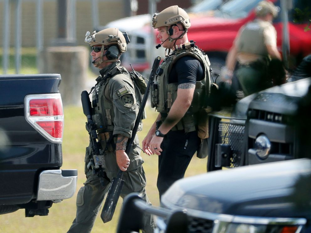 PHOTO: Police officers in tactical gear move through the scene at Santa Fe High School after a shooting on May 18, 2018, in Santa Fe, Texas.