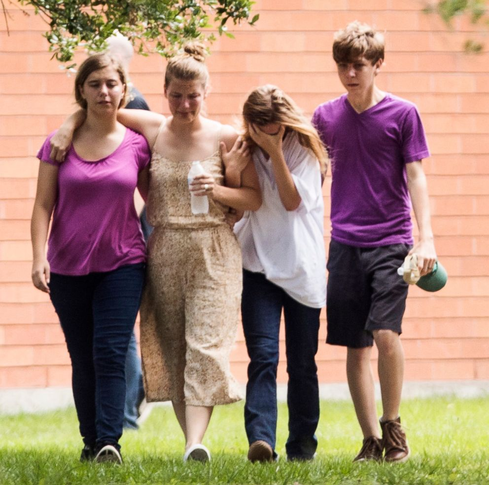 Students gather by the Barnett Intermediate School where parents are gathering to pick up their children following a shooting at Santa Fe High School, May 18, 2018, in Santa Fe, Texas.