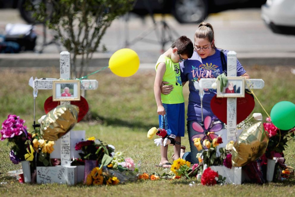 PHOTO: Mourners visit a memorial in front of Santa Fe High School on May 22, 2018, in Santa Fe, Texas.