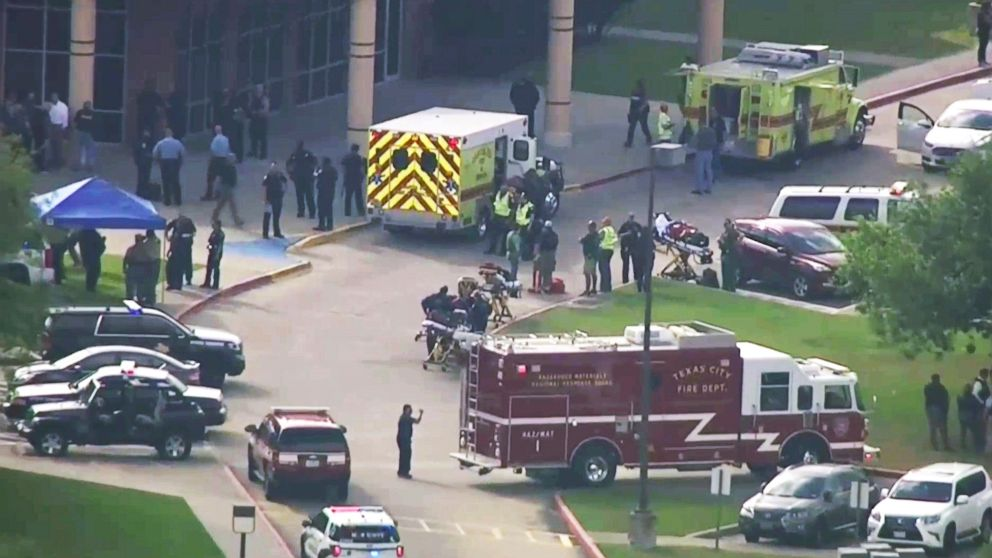 Emergency personnel and law enforcement officers respond to a high school near Houston after an active shooter was reported on campus, May 18, 2018, in Santa Fe, Texas.