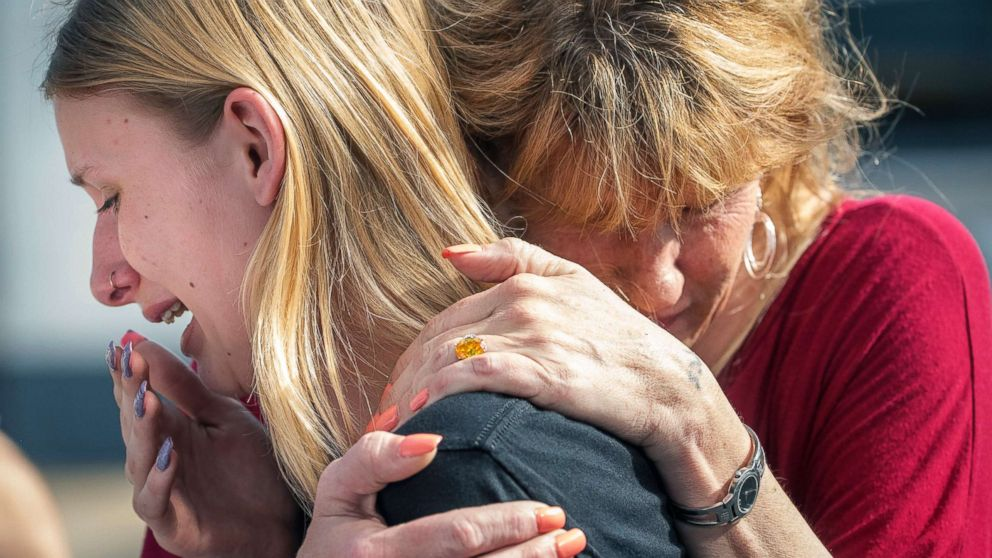 Santa Fe High School student Dakota Shrader is comforted by her mother Susan Davidson following a shooting at the school, May 18, 2018, in Santa Fe, Texas.