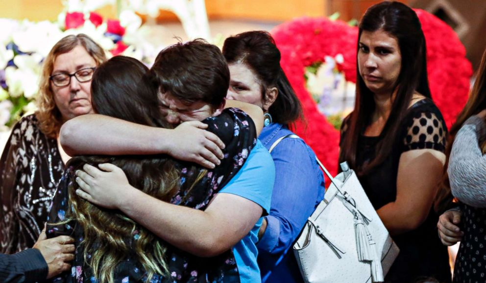 Mourners embrace the family of Christian Riley Garcia during his funeral at Crosby Church on May 25, 2018, in Houston. The 15-year-old student was one of 10 people killed on May 18, 2018, during a mass shooting at Santa Fe High School.