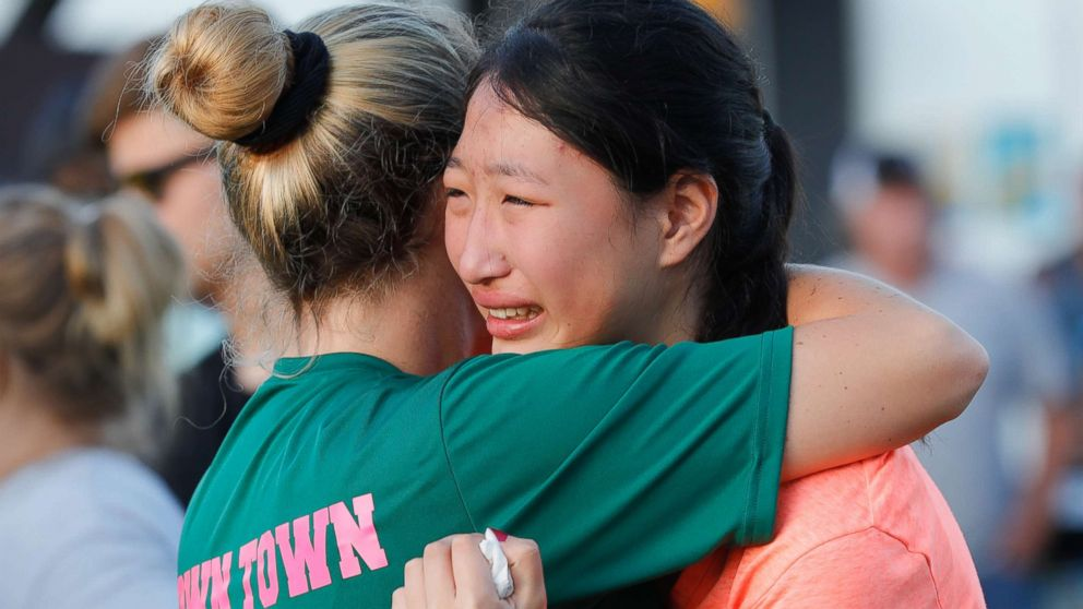 Friends and family attend a vigil held at the First Bank in Santa Fe for the victims of a shooting incident at Santa Fe High School, May 18, 2018 in Santa Fe, Texas.