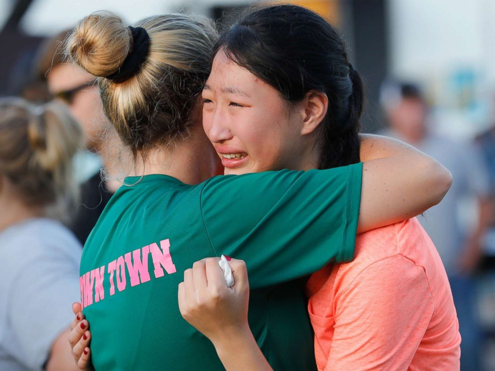 PHOTO: Friends and family attend a vigil held at the First Bank in Santa Fe for the victims of a shooting incident at Santa Fe High School, May 18, 2018 in Santa Fe, Texas.