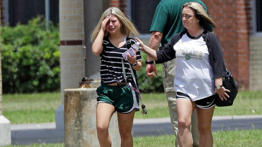 A student, left, reacts after retrieving her belongings inside Santa Fe High School in Santa Fe, Texas, May 19, 2018. Students and teachers were allowed to return to parts of the school to gather their belongings on Saturday.