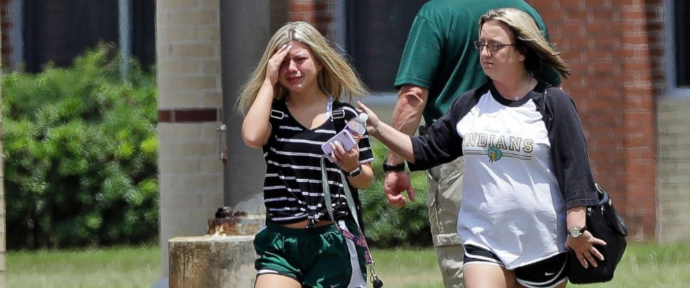 PHOTO: A student, left, reacts after retrieving her belongings inside Santa Fe High School in Santa Fe, Texas, May 19, 2018. Students and teachers were allowed to return to parts of the school to gather their belongings on Saturday.