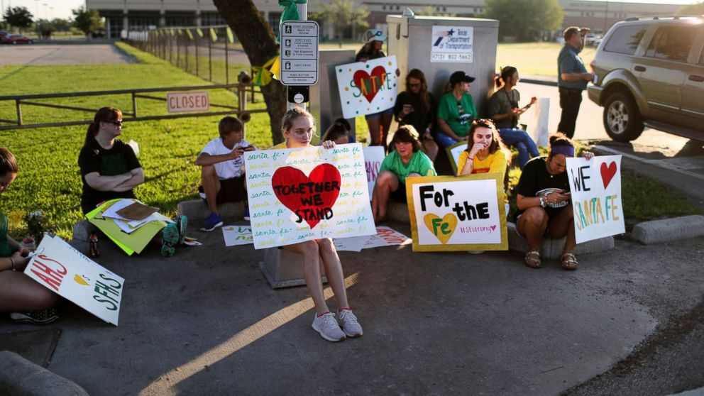 Santa Fe High School supporters gather by the school to wish student and staff well on their first day of classes, May 29, 2018 after a shooting that killed 10 people, in Santa Fe, Texas.