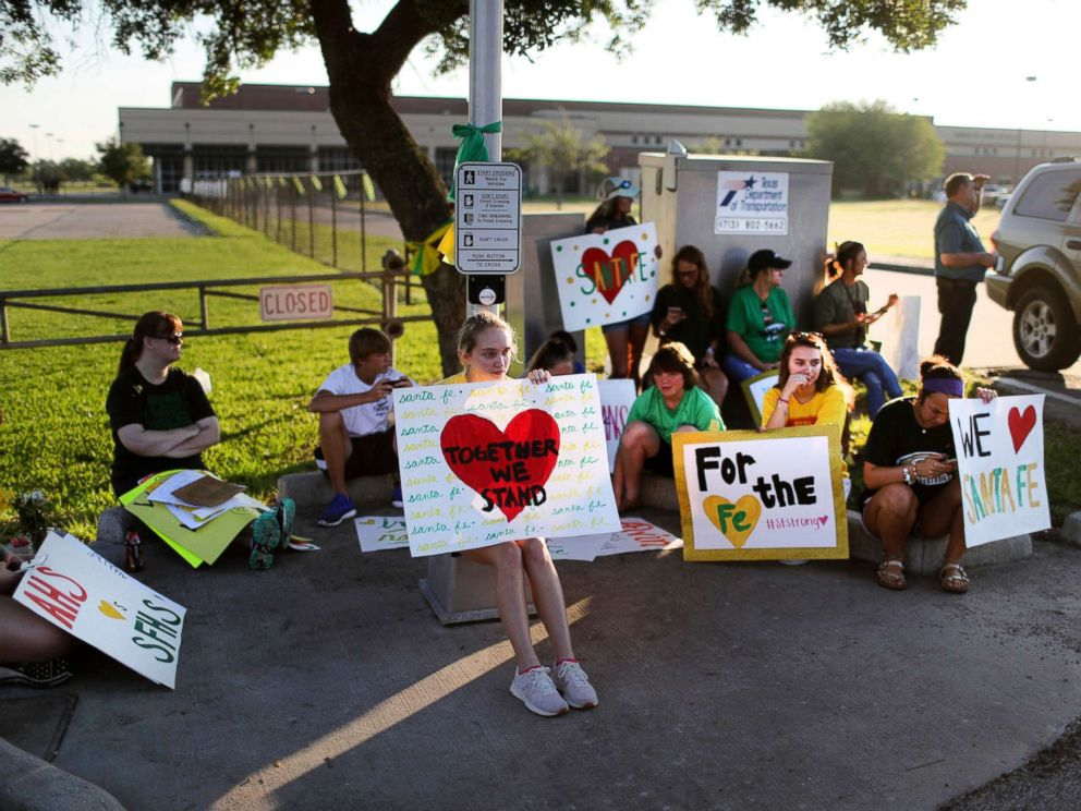 PHOTO: Santa Fe High School supporters gather by the school to wish student and staff well on their first day of classes, May 29, 2018 after a shooting that killed 10 people, in Santa Fe, Texas.