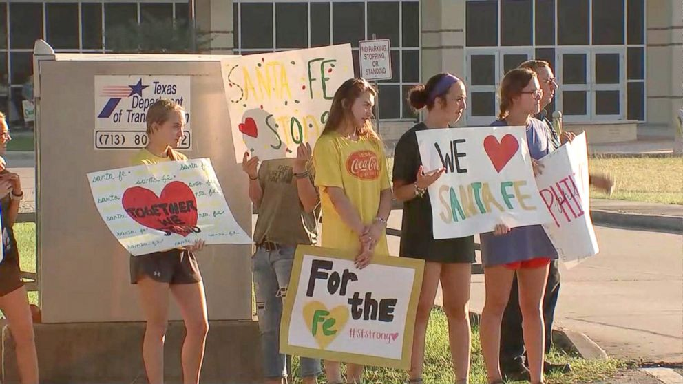 Santa Fe High School students were greeted by community members holding signs of support as they returned to class, May 29, 2018.