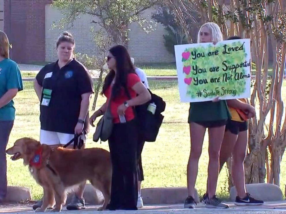 PHOTO: Santa Fe High School students were greeted by community members holding signs of support as they returned to class, May 29, 2018.