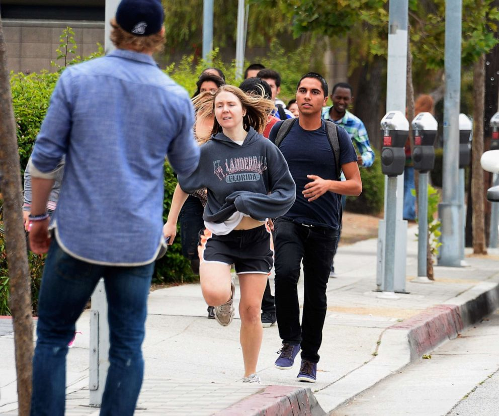 PHOTO:Students rush to safety after shots were fired near the Santa Monica College, June 7, 2013, in Santa Monica, Calif.