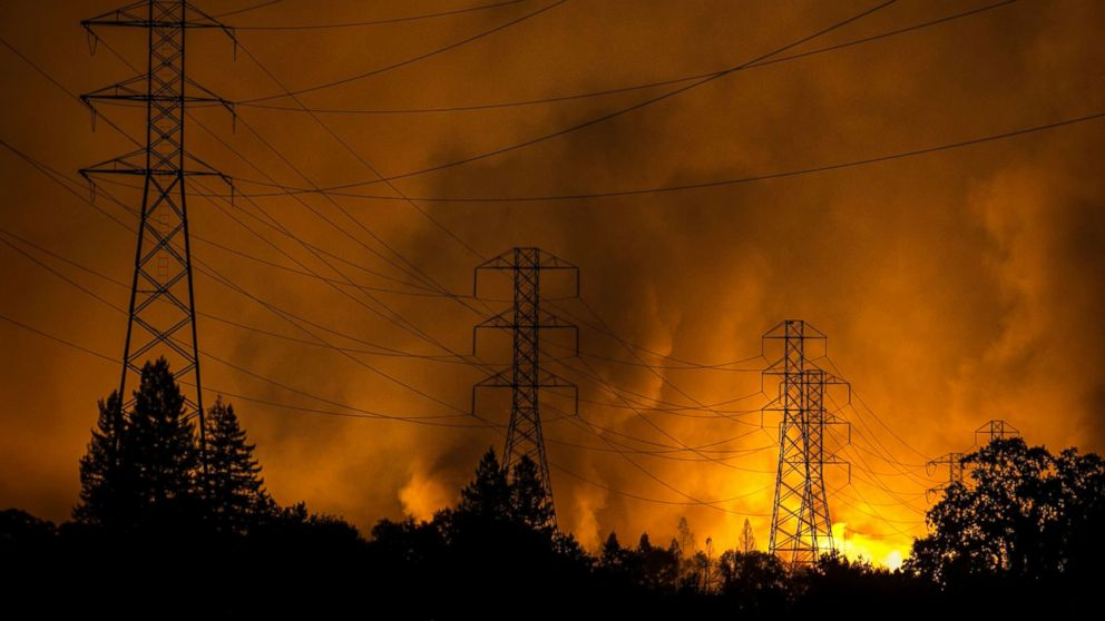A firestorm that began in Napa Valley's Calistoga, roars down the hills from Fountaingrove and into the Coffey Park and Orchard Mobile Home Park neighborhoods, Oct. 9, 2017, in Santa Rosa, Calif.
