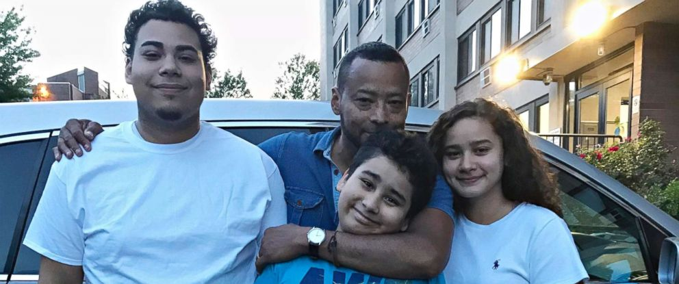 PHOTO: Nelson Rosales Santos with his children.