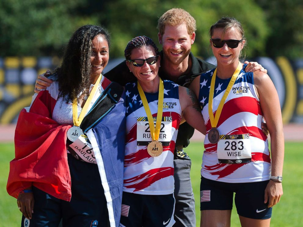 PHOTO: Prince Harry poses with womens 100-meter dash medallists, from the left, Sabrina Daulaus of France, silver, Sarah Rudder of the USA, gold, and Christy Wise of the USA, bronze, at the Invictus Games in Toronto, Sept. 24, 2017.