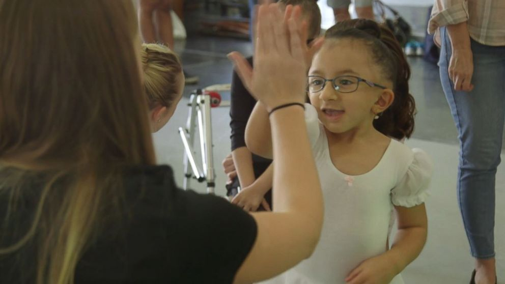 Sarai Arce's mother said her doctors had given her the OK to sign up for additional dance classes after seeing how the workshop had improved her muscle strength.