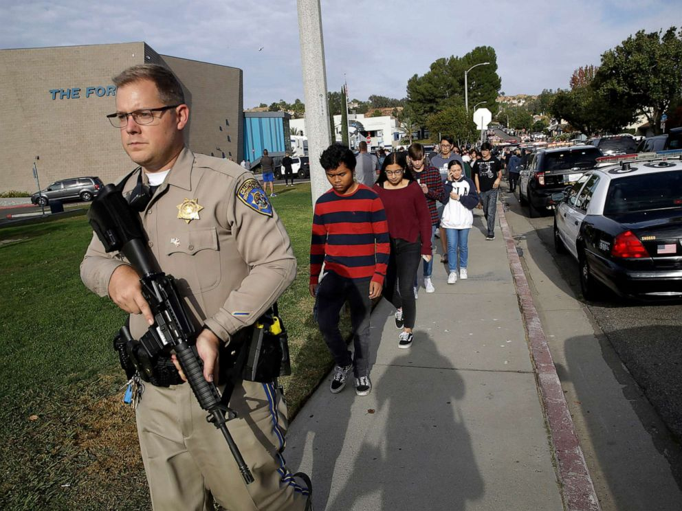 PHOTO: Students are escorted out of Saugus High School after reports of a shooting on Nov. 14, 2019, in Santa Clarita, Calif.