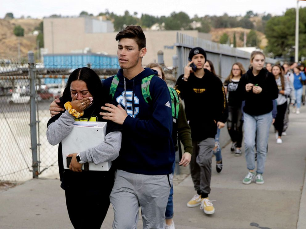 PHOTO: Students are escorted out of Saugus High School after reports of a shooting, Nov. 14, 2019, in Santa Clarita, Calif.
