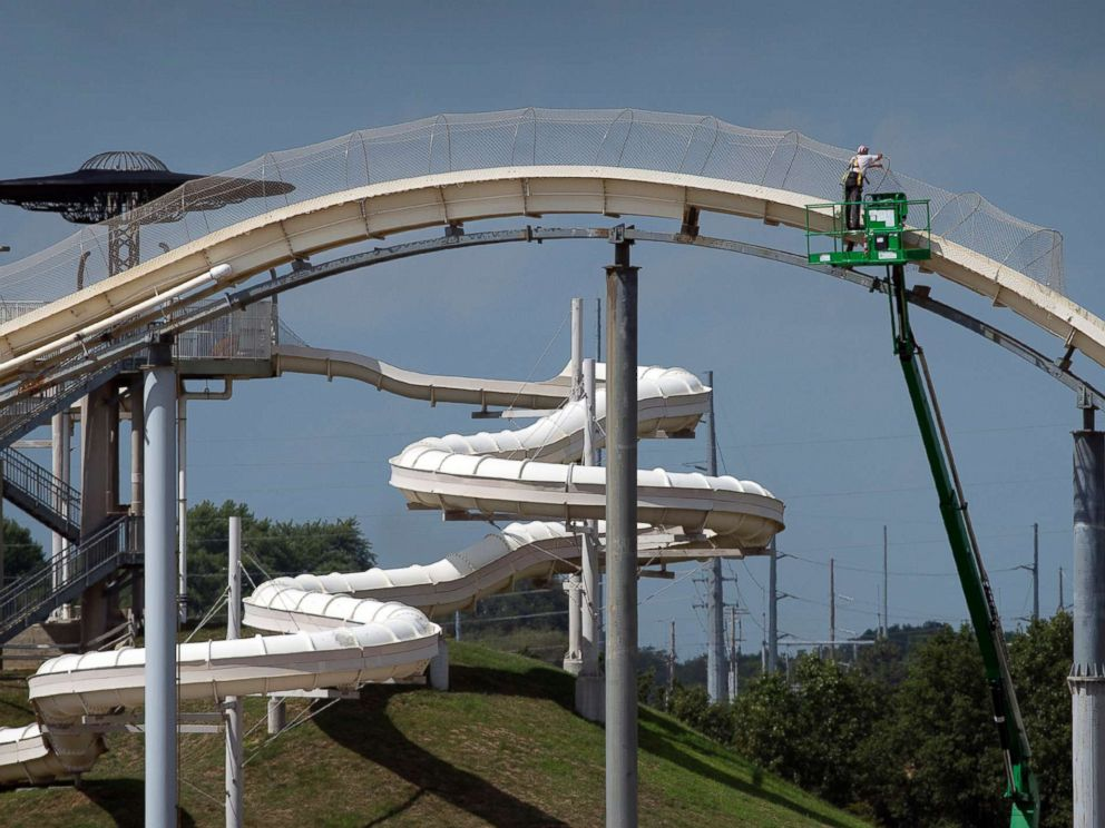 PHOTO: A worker takes down netting from the Verruckt waterslide on Aug. 9, 2016, at the Schlitterbahn Waterpark in Kansas City, Kan.