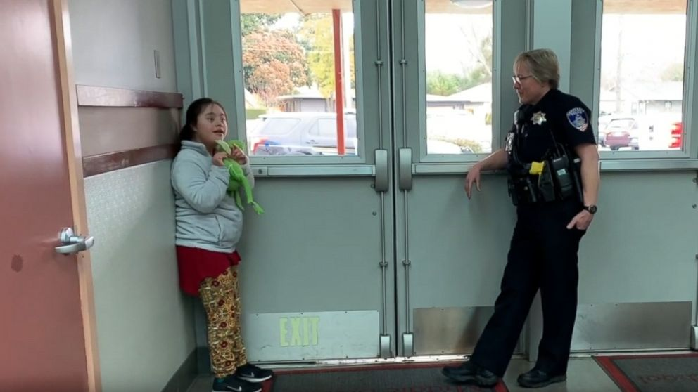 A teacher captured the heartwarming moment a school resource officer soothed a young student with a song at Herbert Slater Middle School in Santa Rosa, Calif.