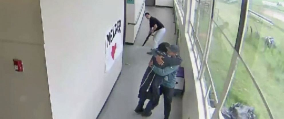PHOTO: A still from a security video from Parkrose High School shows Keanon Lowe hugging a student who brought a shotgun to school.