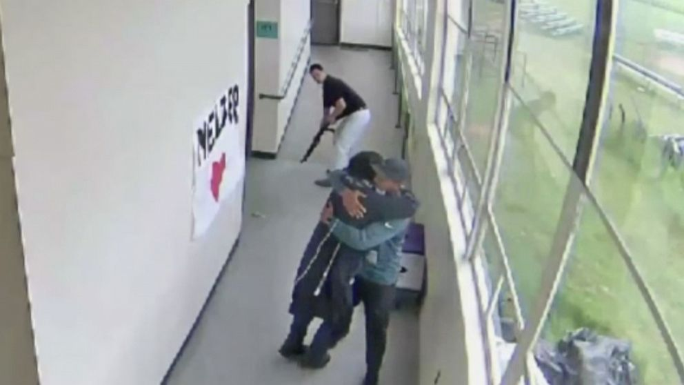 Video shows Oregon coach disarming student then embracing him before police arrive