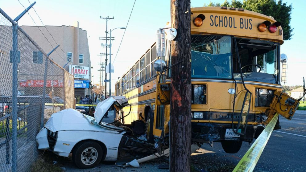 A car is wedged under a school bus that crashed in South Los Angeles on Friday, Jan. 27, 2017. A Fire Department spokesman said there were no injuries to the seven students or the driver aboard the bus.