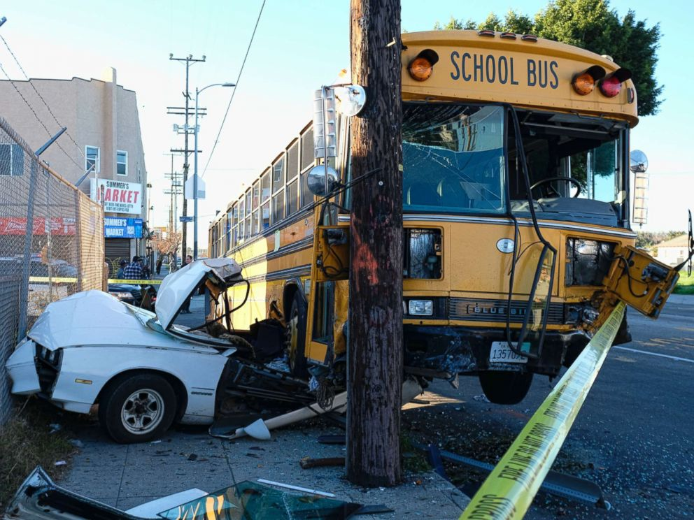 PHOTO: A car is wedged under a school bus that crashed in South Los Angeles on Friday, Jan. 27, 2017.