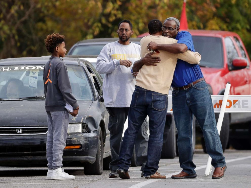 PHOTO: People hug as cars line up to pick up students at Woodmore Elementary School on Nov. 22, 2016, in Chattanooga, Tenn.