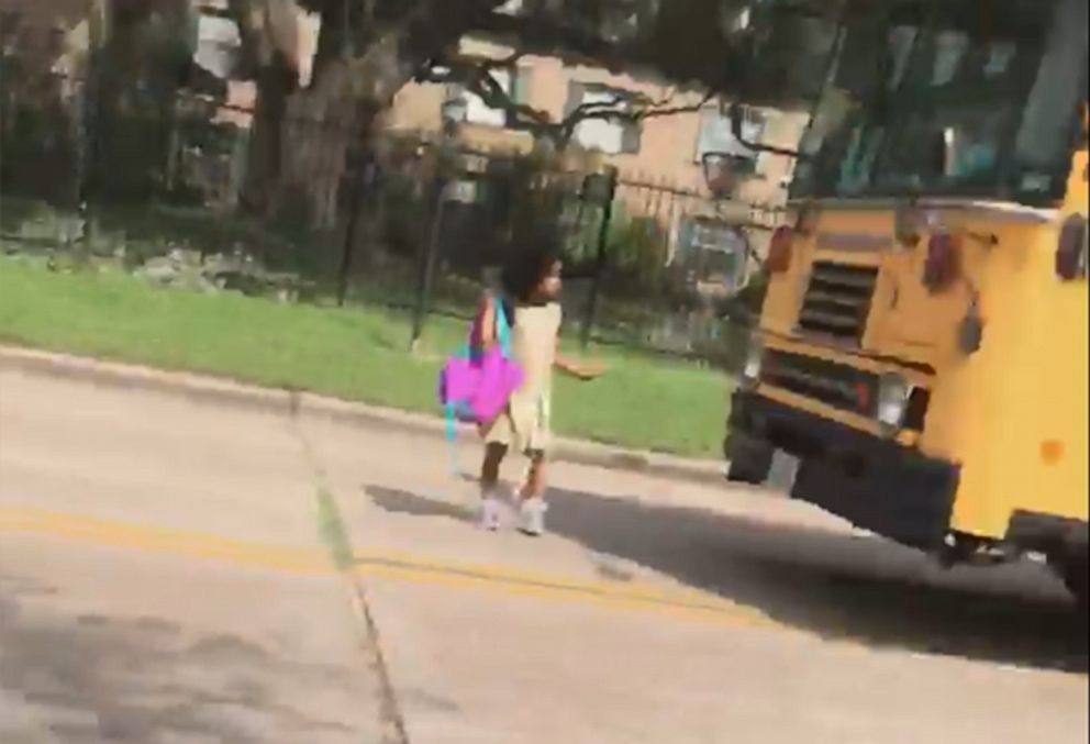 PHOTO: Houston mother Josephine Kirk-Taylor shared a video of a driver blowing past a yellow school bus stop sign Wednesday and nearly striking her kindergarten-age daughter, Melina, as she got off the bus.